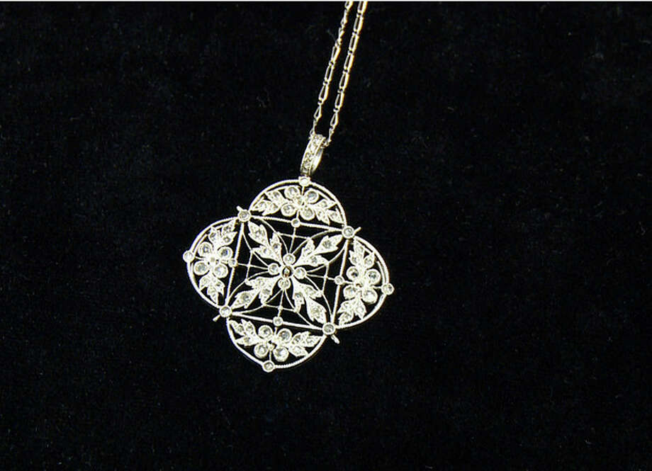 A platinum and diamond necklace recovered from the Titanic is seen in an image made from video. This piece and others begin a three-city tour in Atlanta on Friday, Nov. 16, 2012 and represent the largest collection of jewelry ever on display marking the 100th anniversary of the sinking of the ship. Although single pieces of jewelry have been on display at one or more permanent and traveling exhibits sponsored by Premier Exhibitions Inc., their Atlanta debut is the first time the majority of the collection has been available to the public. (AP Photo/Jpohnny Clark) / AP