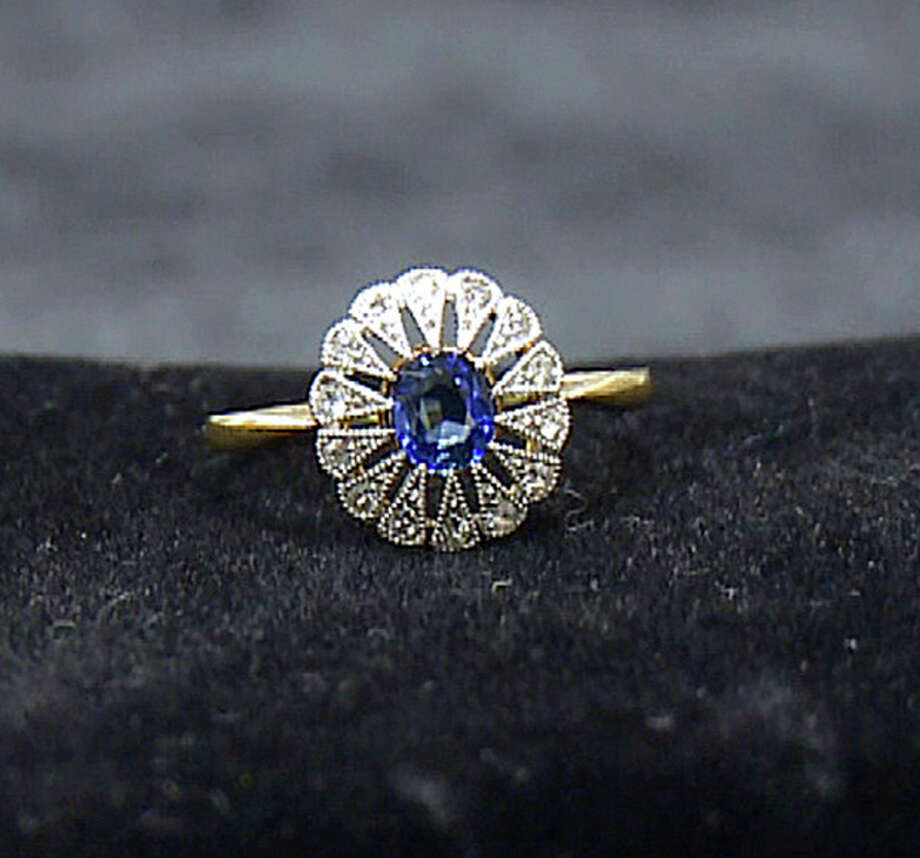 A diamond and sapphire ring recovered from the Titanic is seen in an image made from video. This piece and others begin a three-city tour in Atlanta on Friday, Nov. 16, 2012 and represent the largest collection of jewelry ever on display marking the 100th anniversary of the sinking of the ship. Although single pieces of jewelry have been on display at one or more permanent and traveling exhibits sponsored by Premier Exhibitions Inc., their Atlanta debut is the first time the majority of the collection has been available to the public. (AP Photo/Johnny Clark) / AP