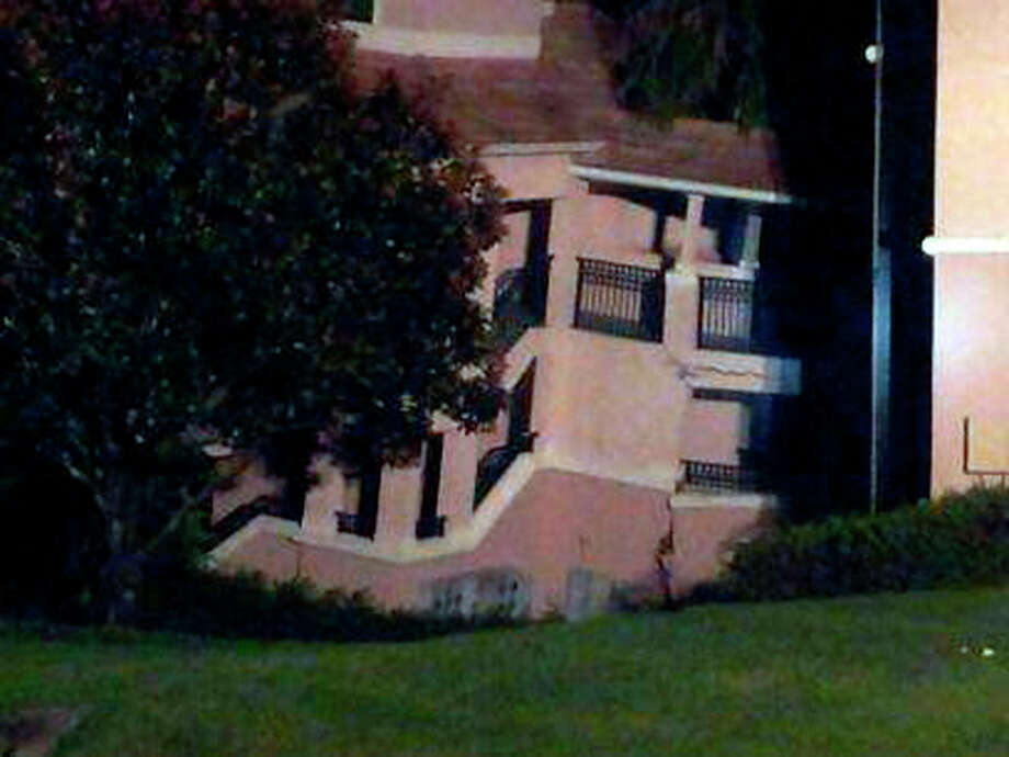 A building at the Summer Bay Resort in Clermont, Fla, shows damage from collapsing into a sinkhole early Monday Aug. 12, 2013. No injuries or victims and all emergency responders were safe and uninjured. All guests that were rescued are being moved to a different building on the property. (AP Photo/Alma Rodriquez) / AP