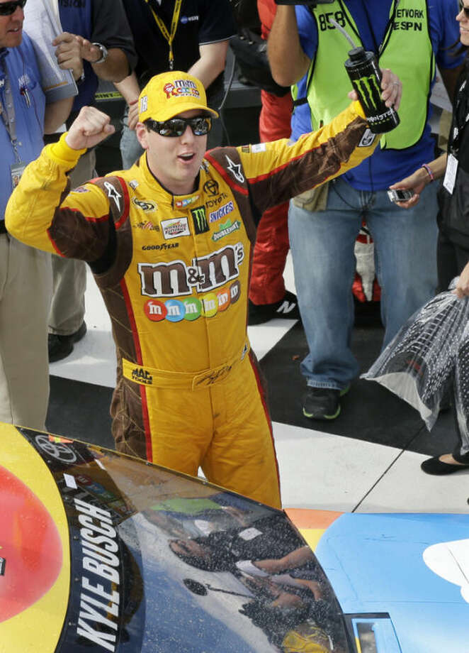 Kyle Busch celebrates in Victory Lane after winning a NASCAR Sprint Cup Series auto race, at The Glen on Sunday, Aug. 11, 2013, in Watkins Glen, N.Y. (AP Photo/Mel Evans)