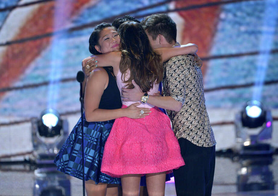 "The cast of ""Glee"", from left, Jenna Ushkowitz, Lea Michele and Kevin McHale hug on stage at the Teen Choice Awards at the Gibson Amphitheater on Sunday, Aug. 11, 2013, in Los Angeles. (Photo by John Shearer/Invision/AP) / Invision"