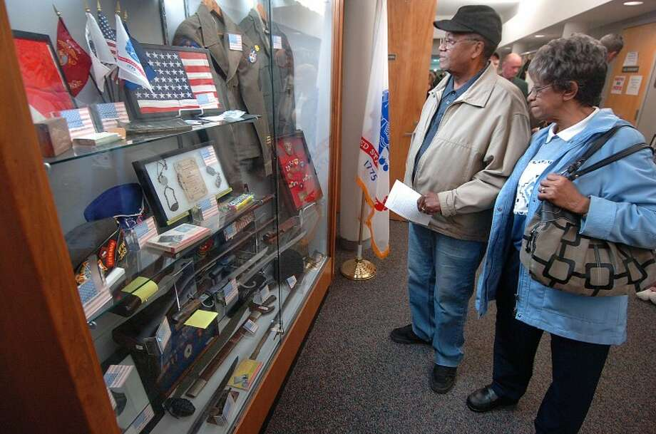 Hour Photo Alex von Kleydorff; Joe and Rose Haywood look at one of the displays in the Veterans Hall of Honor in City Hall