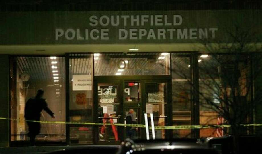 Caution tape blocks the entrance of the Southfield Police Department, Sunday, Nov. 11, 2012 in Southfield, Mich. Southfield Police in say a man who opened fire in a police station was killed in a shootout with officers. (AP Photo/Detroit Free Press, Mandi Wright) / Detroit Free Press