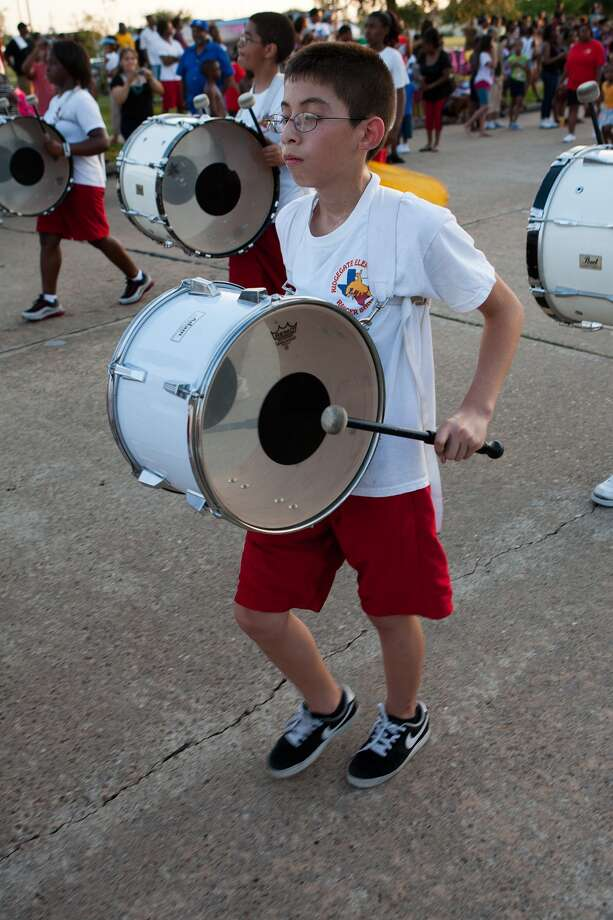 """Bands are always part of the annual """"One Mile of Smiles"""" parade. This year's parade will begin at 7 p.m. June 18 at FM 2234 and Court Road. Above, Carlos Guzman, of the Ridgegate Elementary School Rangers Marching Band plays in the 10th annual Juneteenth Parade.  Photo: R. Clayton McKee, Freelance / © R. Clayton McKee"""