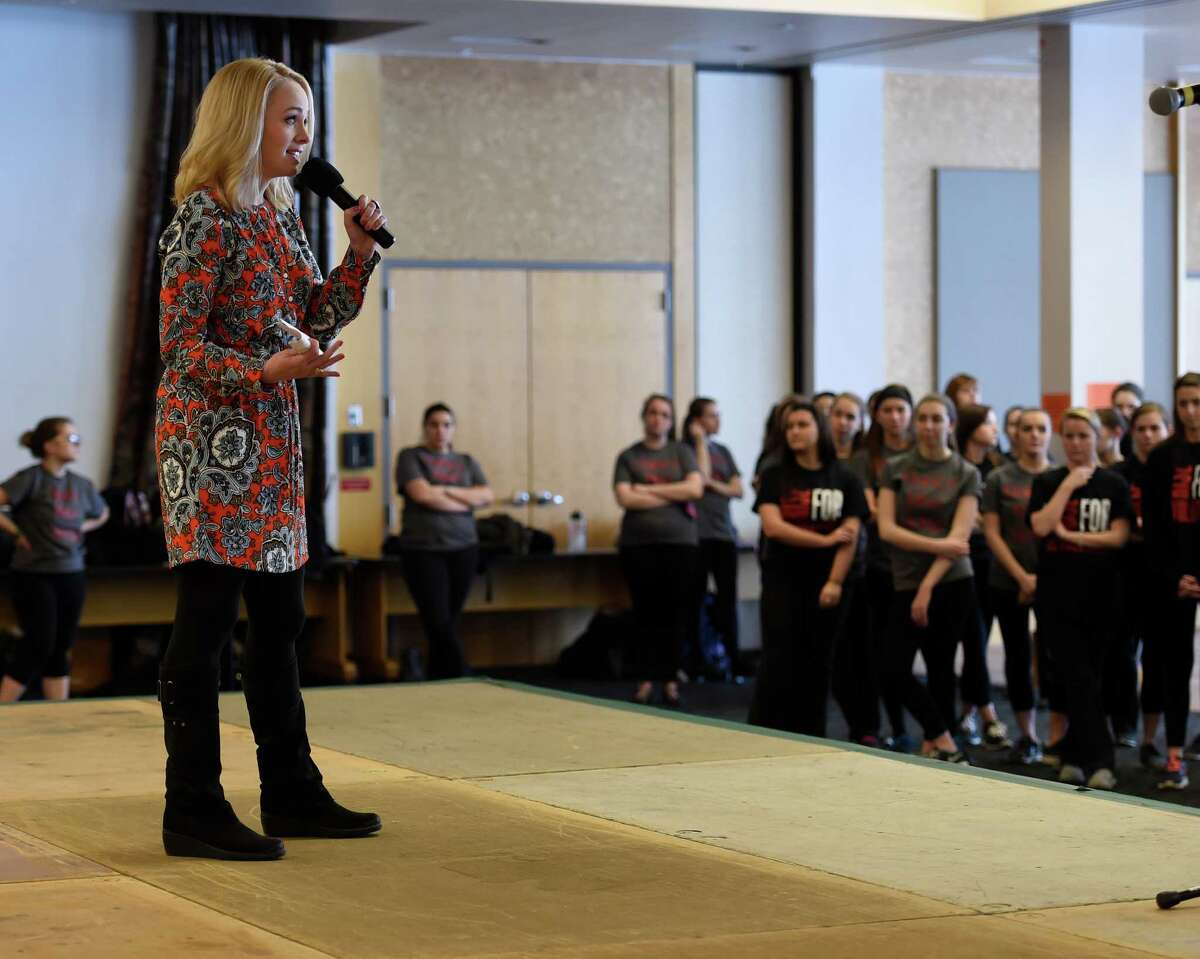 Local TV personality Kate Welshofer welcomes the large crowd of students to the One Billion Rising Siena College rally held at the Student Center on the Siena campus Friday Feb. 12, 2016 in Loudonville, N.Y. One Billion Rising bring attention to the statistic that 1 in 3 women in the world (approximately 1 billion women) will be beaten or raped during her lifetime. (Skip Dickstein/Times Union)