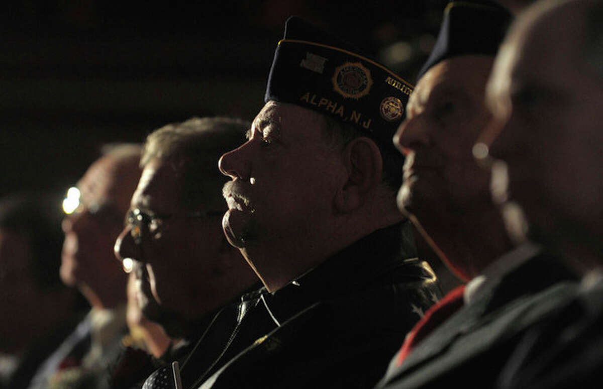 Military Veterans sit a listen to a Veterans Day Tribute ceremony, during which they will receive their high school diplomas that they did not get since they left school to serve in the military at Phillipsburg High School in Phillipsburg, NJ, Sunday, Nov. 11, 2012. (AP Photo/The Express-Times, Matt Smith)