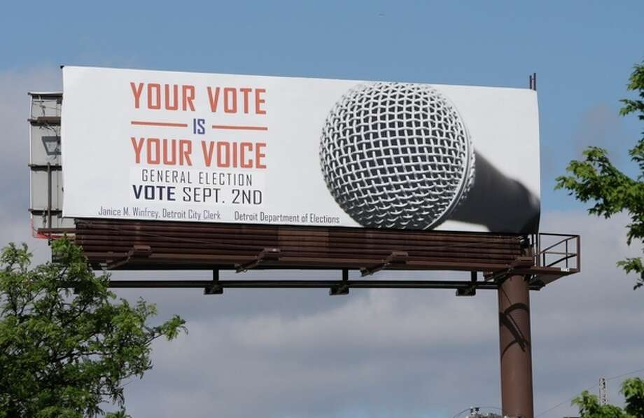 """One of the billboards seen on Tuesday, Aug. 13, 2013, promoting Detroit's upcoming general election offered up some erroneous information about when to go to the polls. The Detroit Free Press reports that many of the 14 billboards gave a September date for the election. The vote will actually take place Nov. 5. City Clerk Janice Winfrey says the billboards were updated Saturday with information about the general election, and she calls the September date """"a mistake"""" by the business that handles the billboards. (AP Photo/Carlos Osorio) / AP"""