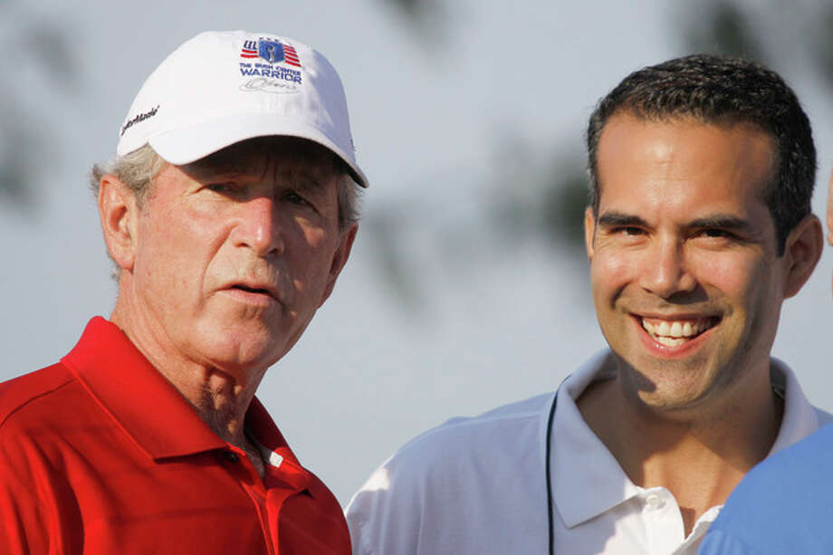 FILE - In this Monday, Sept. 24, 2012, file photo George P. Bush, right, stands with his uncle former President George W. Bush, left, during the Bush Center Warrior Open in Irving, Texas. George P. Bush, son of one-time Florida Gov. Jeb Bush, has made a campaign filing in Texas that is required of candidates planning to run for state office, an official said Thursday, Nov 8, 2012. (AP Photo/LM Otero, File) / AP