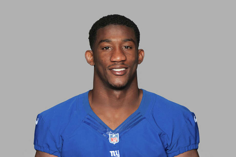 """FILE - This is a 2013 file photo showing New York Giants football player Antrel Rolle. Rolle says he sustained a """"pretty good"""" sprain to his right ankle and does not know when he will be able to return to practice. The Giants leading tackler the past two seasons, Rolle wore a protective boot on his foot in talking to the media for the first time since being hurt at practice Monday, Aug. 12, 2013. (AP Photo/File) / NFLPV AP"""