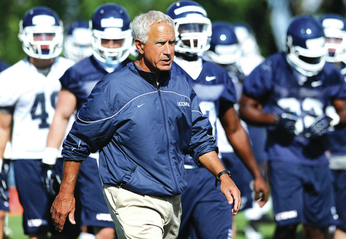 AP photo Connecticut head coach Paul Pasqualoni walks with his team during a recent practice in Storrs. Pasqualoni is in his third season since replacing Randy Edsall as the Huskies' head coach. After two 5-7 seasons, he knows it's time to produce.