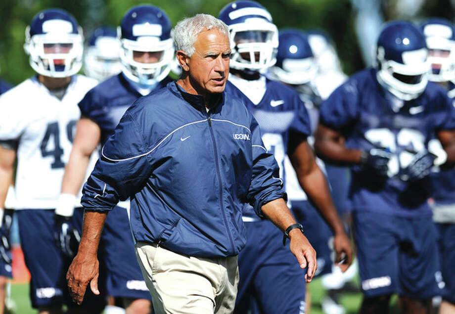 AP photoConnecticut head coach Paul Pasqualoni walks with his team during a recent practice in Storrs. Pasqualoni is in his third season since replacing Randy Edsall as the Huskies' head coach. After two 5-7 seasons, he knows it's time to produce. / FR125654 AP