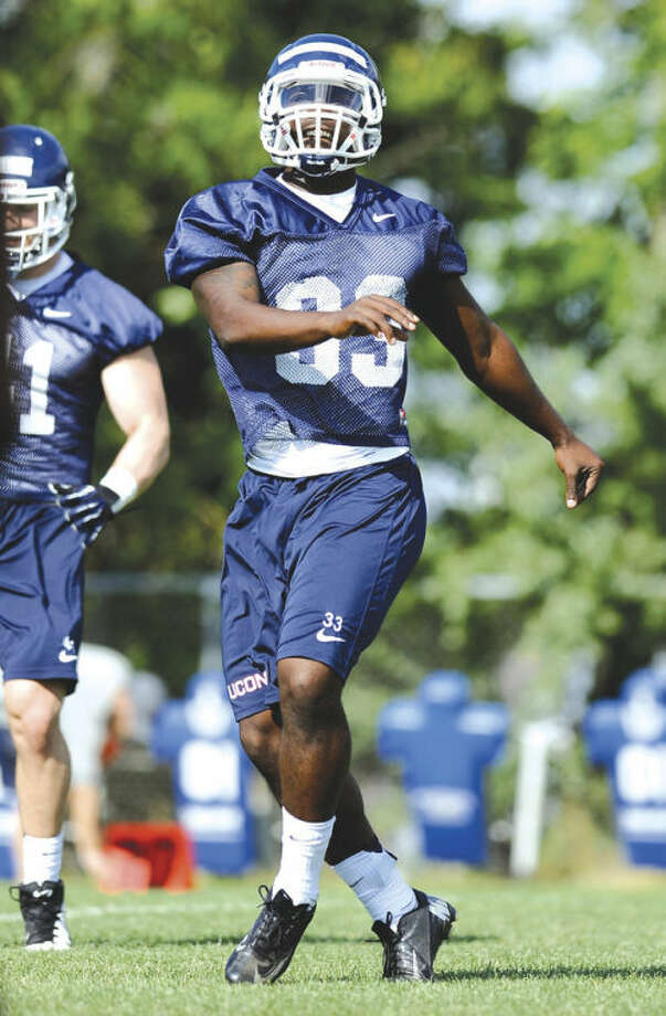 Connecticut linebacker Yawin Smallwood runs a drill during a recent practice in Storrs. Smallwood is being counted upon to fill a leadership void on the Huskies' defensive unit.AP photo