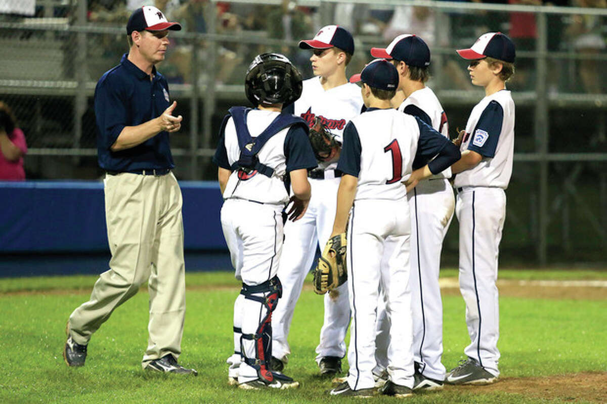 Hour photo/Chris Palermo Wesport Little League head coach Tim Rogers speaks with his players near the mound during an Aug. 2 game at the Giamatti Little League complex in Bristol. The Westport squad started its undefeated run through the New England Regionals that night with a 9-2 win over South Burlington, Vt. That run carried Westport to a berth in the Little League World Series in Williamsport, Pa.