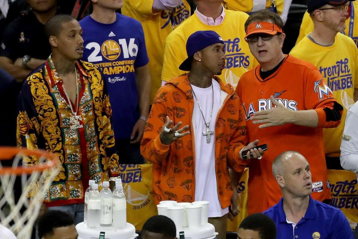 Oakland rapper A.E. accompanied former Kylie Jenner paramourTygato Game 5. In a truly odd turn of events, they were seen talking to Marlins Man.
