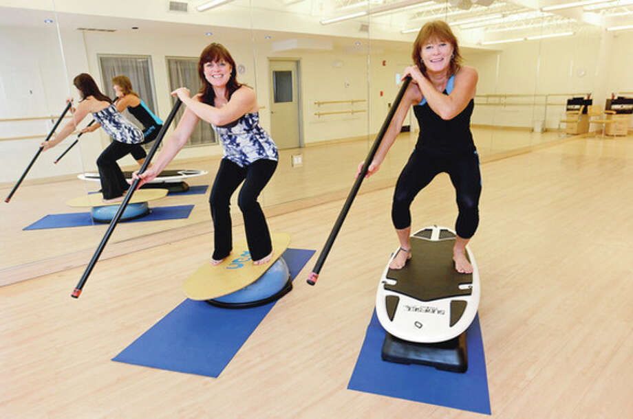 Kim Beaumont and Karen Jewell of Downunder Fitness & Surf in Westport.Hour photo / Erik Trautmann / (C)2012, The Hour Newspapers, all rights reserved