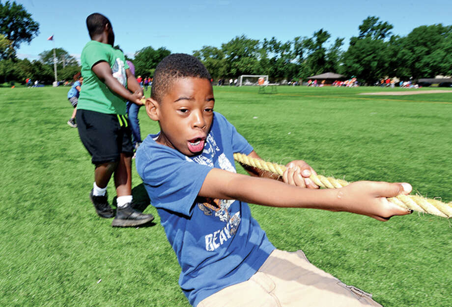 Isaiah Jackson, 10, competes in the tug of war as The Boys & Girls Club of Stamford hosts their First Annual Community Fitness Day Wednesday. Approximately 250 children will participated in a variety of fun fitness events to reinforce the importance of living an active, healthy lifestyle. Hour photo / Erik Trautmann / (C)2013, The Hour Newspapers, all rights reserved