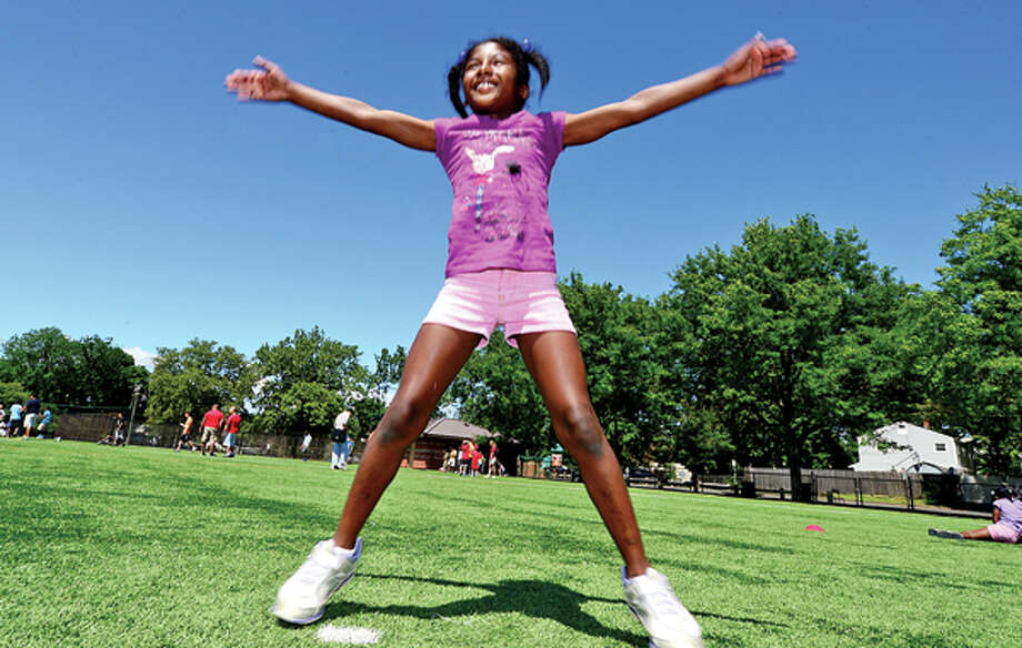 Shantel Silpot, 9, perfroms jumping jacks as The Boys & Girls Club of Stamford hosts their First Annual Community Fitness Day Wednesday. Approximately 250 children will participated in a variety of fun fitness events to reinforce the importance of living an active, healthy lifestyle. Hour photo / Erik Trautmann / (C)2013, The Hour Newspapers, all rights reserved