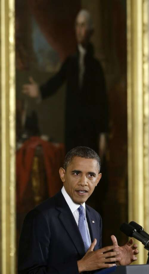 President Barack Obama makes an opening statement during a news conference in the East Room of the White House in Washington Wednesday, Nov. 14, 2012. (AP Photo/Charles Dharapak)