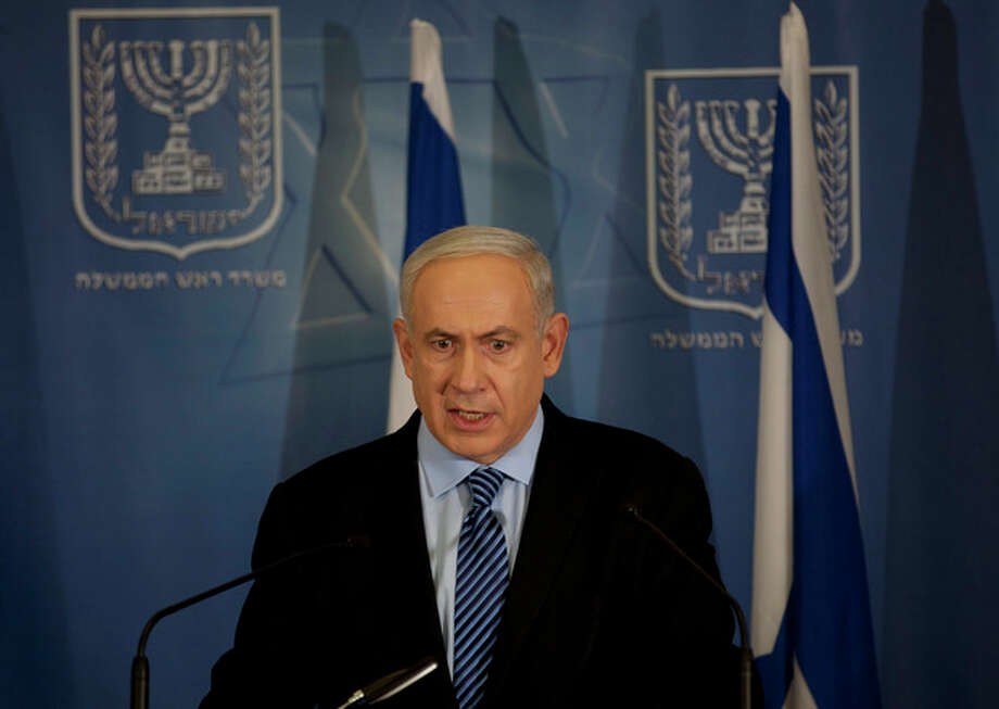 "Israel's Prime Minister Benjamin Netanyahu delivers a statement to the media at Hakirya a military base in Tel Aviv, Israel, Wednesday, Nov. 14, 2012. Israel's prime minister says the military is prepared to broaden its operation against Hamas targets in Gaza. Benjamin Netanyahu says Israel cannot tolerate continued rocket attacks against its citizens. In his first comments since Israel killed the commander of the Hamas military wing, Netanyahu said Wednesday that Israel is ""prepared to expand the operation"". (AP Photo/Ariel Schalit) / AP"