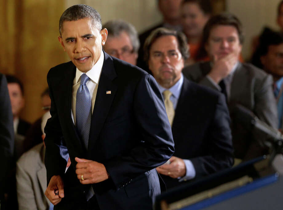 President Barack Obama steps up to the podium before a news conference in the East Room of the White House in Washington Wednesday, Nov. 14, 2012. (AP Photo/Charles Dharapak) / AP