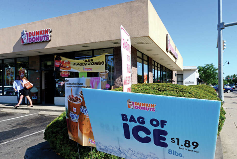 The Dunkin Donuts on West Ave. Thieves broke into three local businesses, including two Dunkin' Donuts, overnight Tuesday. Hour photo / Erik Trautmann / (C)2013, The Hour Newspapers, all rights reserved