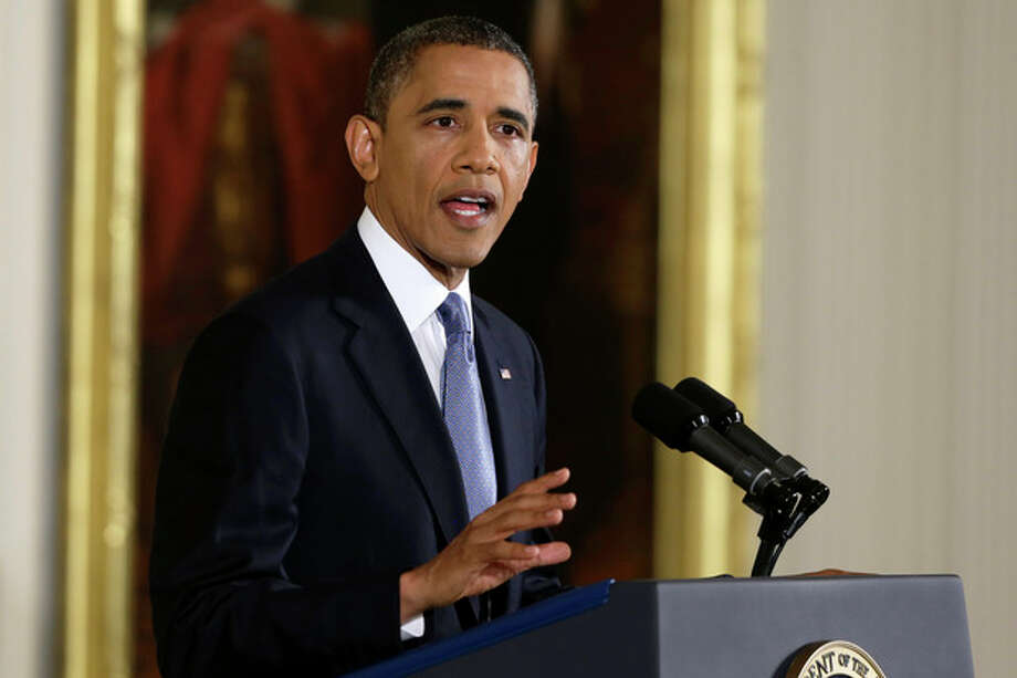 President Barack Obama makes an opening statement during his first news conference after Election Day, Wednesday, Nov. 14, 2012, in the East Room of the White House in Washington. (AP Photo/Charles Dharapak) / AP