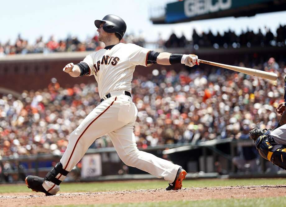 Buster Posey hits a two-run single against Milwaukee Brewers on June 15 at AT&T Park. Photo: Scott Strazzante, The Chronicle