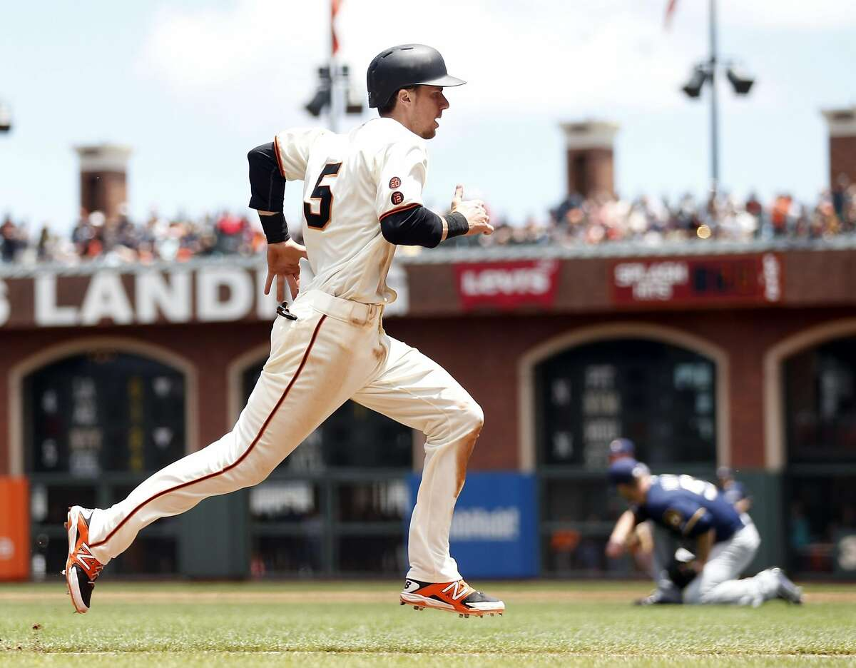San Francisco Giants' Matt Duffy scores on throwing error by Milwaukee Brewers' Martin Maldonado in 3rd inning during MLB game at AT&T Park in San Francisco, Calif., on Wednesday, June 15, 2016.