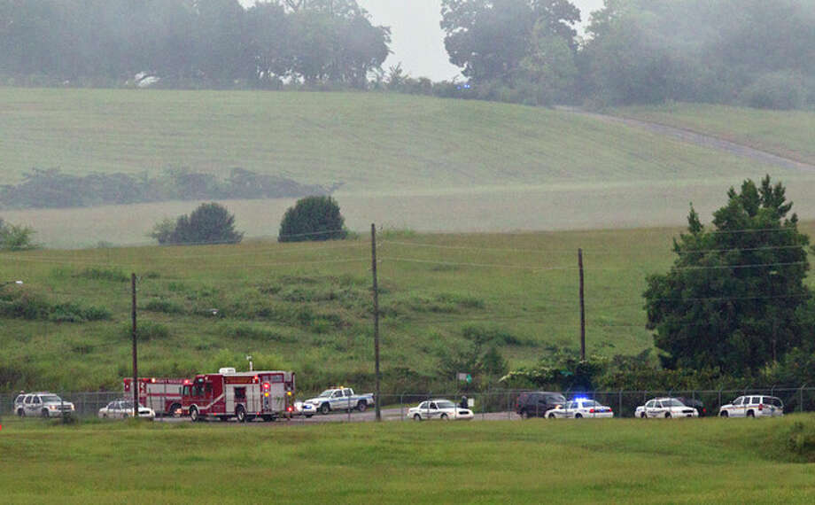 Fire crews arrive on scene of a plane crash at the Birmingham International Airport in Birmingham, Ala., on Wednesday, Aug. 14, 2013. An airport spokeswoman says the large UPS cargo plane that crashed went down in an open field just outside the airport. (AP Photo/Butch Dill) / FR111446 AP