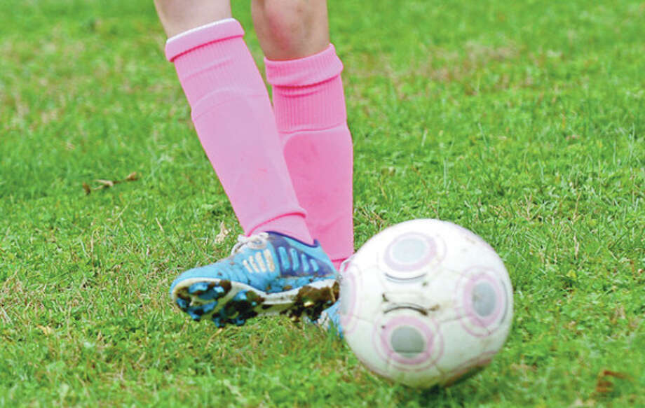 Players sported pink in honor of National Junior Soccer Association's Breast Cancer Awareness Day.Hour photo / Erik Trautmann / (C)2012, The Hour Newspapers, all rights reserved