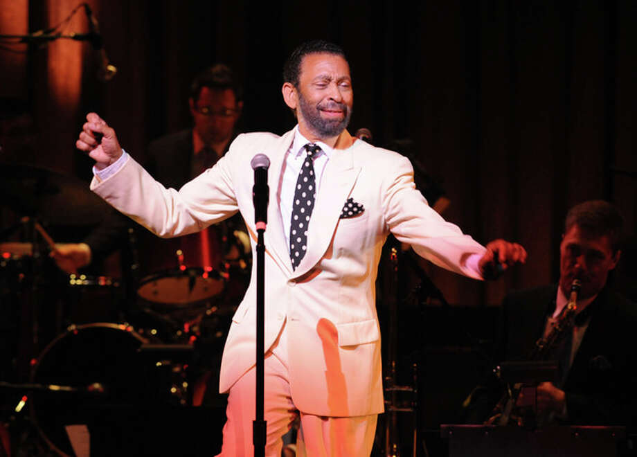 """In this May 2011 photo provided by the Apollo Theater, director/choreographer Maurice Hines is seen on stage that the Apollo Theater in New York. Hines will host three performances of """"Apollo Club Harlem,"""" in February 2013. Hines directed and choreographed the production. (AP Photo/The Apollo Theater, Shahar Azran) / The Apollo Theater"""