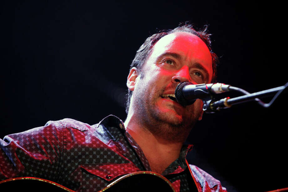 FILE - This Sept. 22, 2012 file photo shows Dave Matthews of the Dave Matthews Band performing during the Farm Aid 2012 concert at Hersheypark Stadium in Hershey, Pa. The band is giving $1 million to help Superstorm Sandy recovery efforts in New Jersey and New York. They announced Wednesday, Nov. 14, that the Nov. 30 opening show of their tour at the IZOD Center in East Rutherford, N.J., will be a benefit concert. All tickets and merchandise sales will go to the Bama Works Sandy Relief Fund, established at the Community Foundation of New Jersey. (AP Photo/Jacqueline Larma, file) / AP