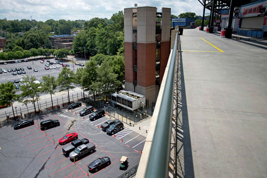 The player's parking lot is seen from the upper-level platform from where 30-year-old Ronald Homer fell during Monday night's game at Turner Field, Tuesday, Aug. 13, 2013, in Atlanta. It was at least the third time a sports fan has fallen from a stadium in Atlanta in the past year. Homer fell more than 60 feet (18 meters) from the upper levels of Turner Field onto a parking lot on Monday night. At least four witnesses told police that no one else was standing near him when he fell over a fourth-level railing into a parking lot for players. Homer's death appeared to be an accident, authorities said. (AP Photo/David Goldman) / AP