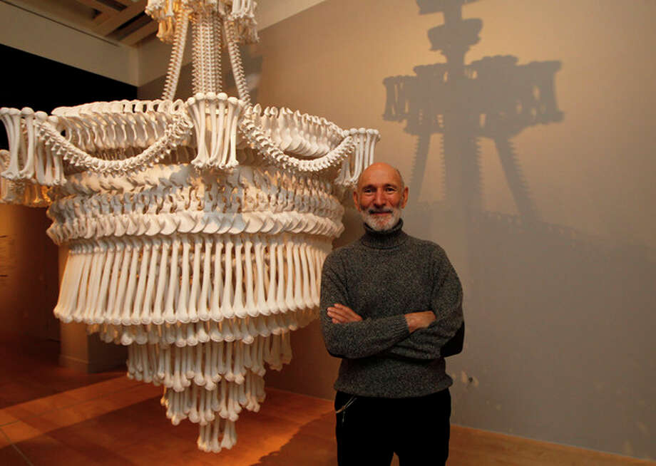 Collector Richard Harris poses with one of his collection of installation 'In the Eyes of Others' by British artist Jodie Carey on display at an exhibition 'Death : The Richard Harris Collection' at the Wellcome Collection gallery in London, Wednesday, Nov. 14, 2012. (AP Photo/Sang Tan) / AP