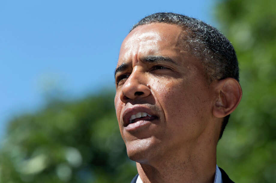 President Barack Obama makes a statement to the media regarding events in Egypt, from his rental vacation home in Chilmark Mass., on the island of Martha's Vineyard, Thursday, Aug. 15, 2013. The president announced that the US is canceling joint military exercise with Egypt amid violence. (AP Photo/Jacquelyn Martin) / AP