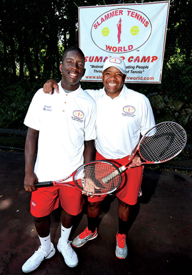 Marcus Hooks who trains with Slammin Tennis of Norwalk and his coach Marvin Tyler. Hour photo / Erik Trautmann / (C)2013, The Hour Newspapers, all rights reserved