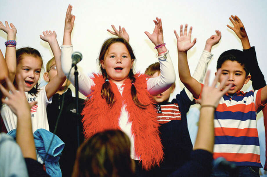 Springdale School 3rd graders put on a patriotic performance to thank area veterans for their service Wednesday.Hour photo / Erik Trautmann / (C)2012, The Hour Newspapers, all rights reserved