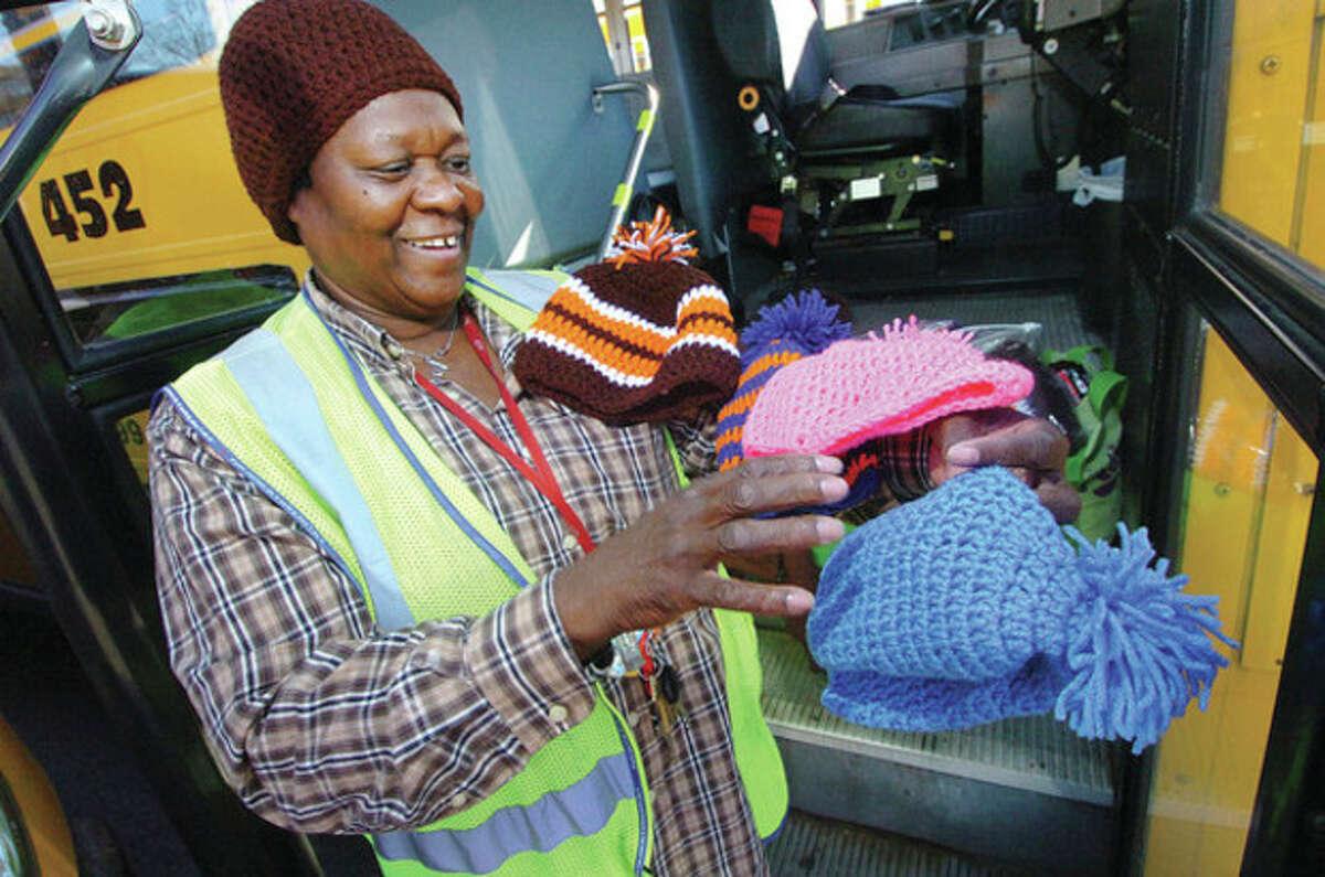Hour photo / Alex von Kleydorff Norwalk schoolbus driver Lettie Nash shows some of the 40 hats she crocheted for her Cranbury Elementary schoolchildren who ride her bus.