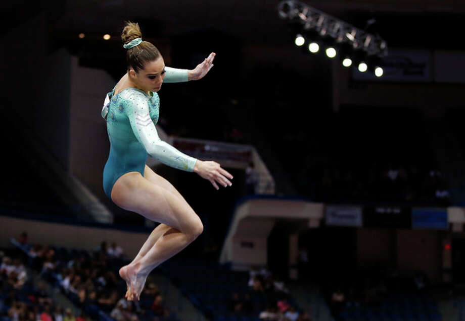 McKayla Maroney competes in the floor exercise during the U.S. women's national gymnastics championships in Hartford, Conn., Thursday, Aug. 15, 2013. (AP Photo/Elise Amendola) / AP