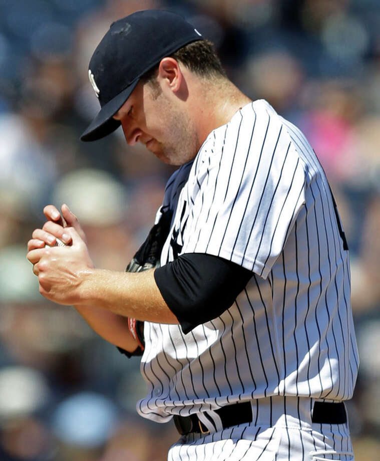 New York Yankees starting pitcher Phil Hughes reacts after allowing a fourth-inning solo home run to Los Angeles Angels' Chris Nelson in a baseball game, Thursday, Aug. 15, 2013, in New York. (AP Photo/Kathy Willens) / AP