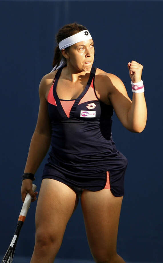 Marion Bartoli, from France, reacts during a match against Simona Halep, from Romania, at the Western & Southern Open tennis tournament, Wednesday, Aug. 14, 2013, in Mason, Ohio. (AP Photo/David Kohl)