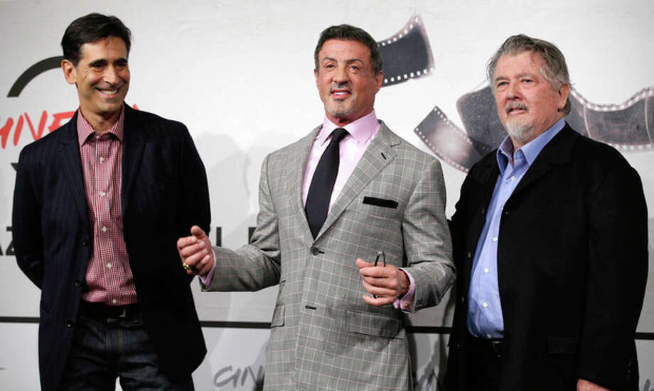 """From left, writer Alessandro Camon, actor Sylvester Stallone and director Walter Hill pose during the photo call of the movie """"Bullet to the Head"""" at the 7th edition of the Rome International Film Festival in Rome, Wednesday, Nov. 14, 2012. (AP Photo/Andrew Medichini) / AP"""