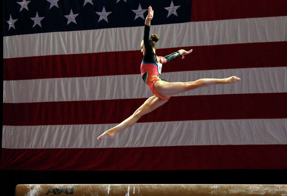 Abigail Milliet competes on the balance beam during the U.S. women's national gymnastics championships in Hartford, Conn. Thursday, Aug. 15, 2013. (AP Photo/Elise Amendola) / AP