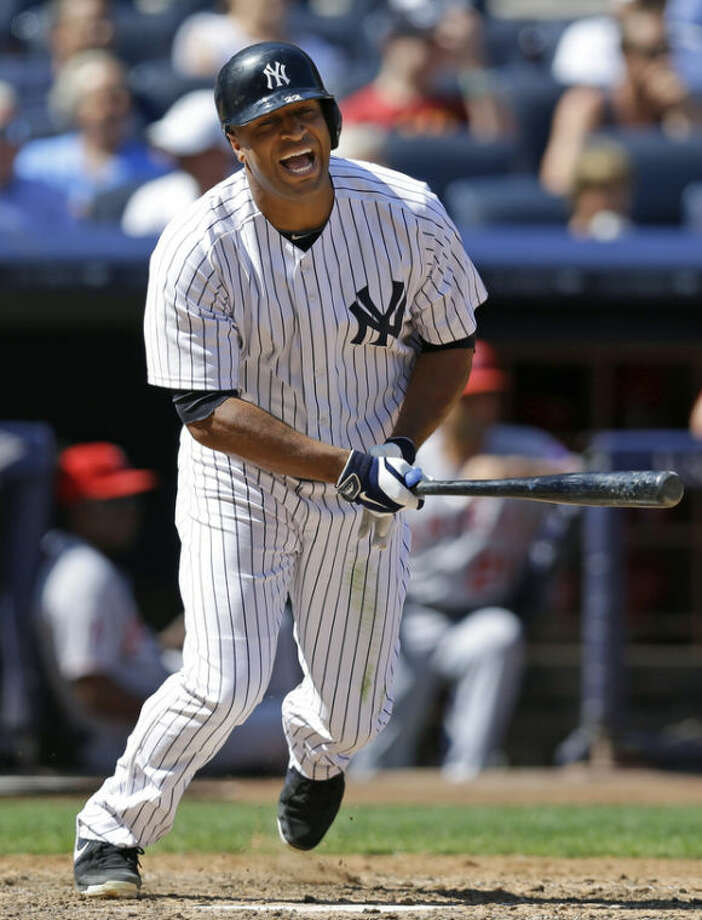 New York Yankees' Vernon Wells reacts after grounding out to third in the fifth inning of a baseball game against the Los Angeles Angels, Thursday, Aug. 15, 2013, in New York. (AP Photo/Kathy Willens)