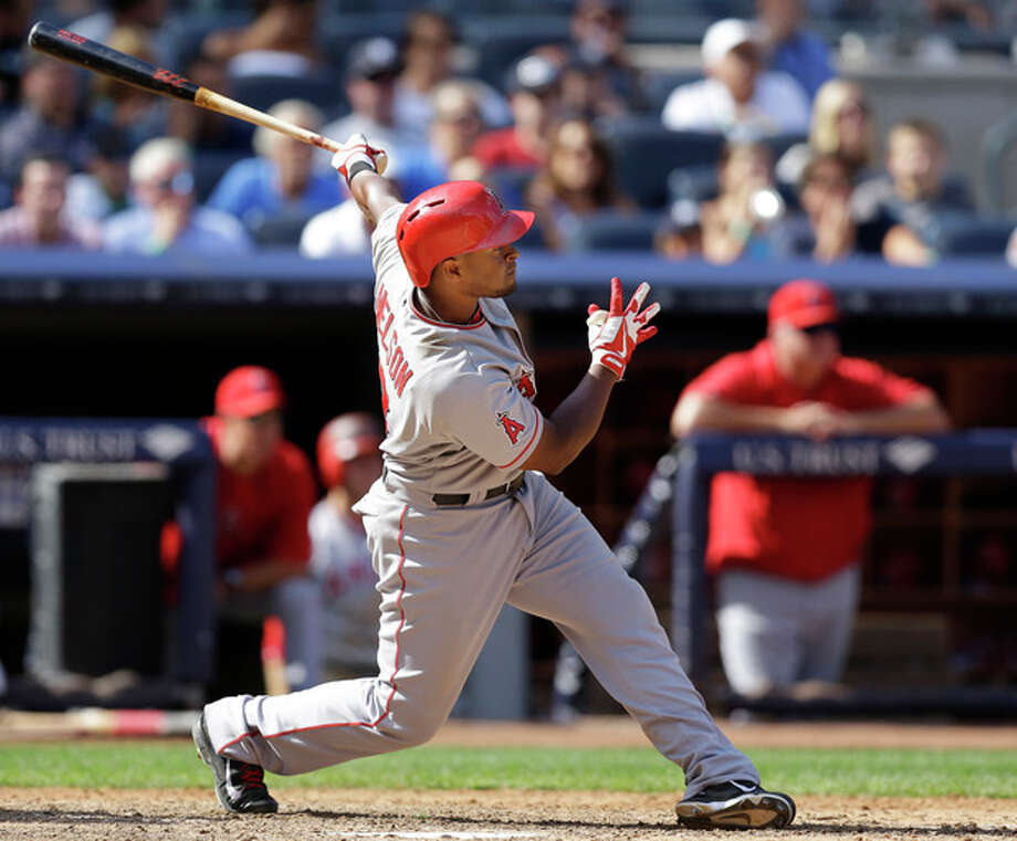 Los Angeles Angels' Chris Nelson follows through on an eighth-inning grand slam off New York Yankees relief pitcher Boone Logan in a baseball game Thursday, Aug. 15, 2013, in New York. Nelson also hit a fourth-inning solo home run. (AP Photo/Kathy Willens) / AP