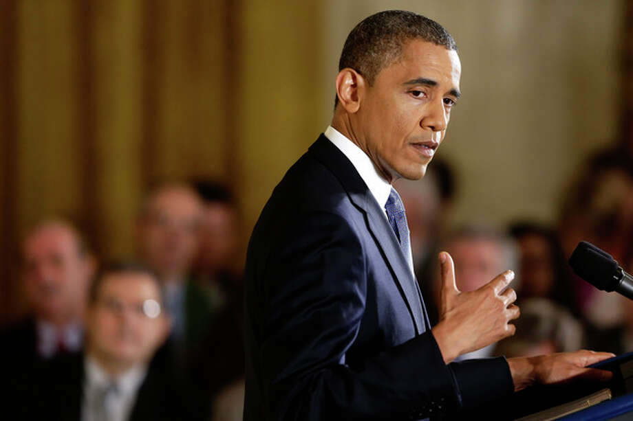 President Barack Obama gestures as he answers a question during a news conference in the East Room of the White House in Washington, Wednesday, Nov. 14, 2012. (AP Photo/Charles Dharapak) / AP