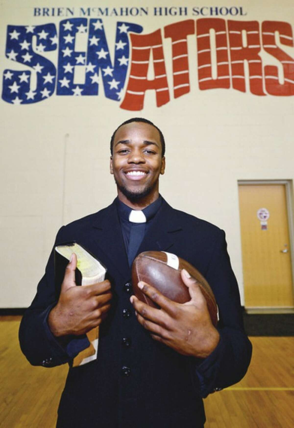 """Hour photo/Erik Trautmann Kyle Jordan, a Brien McMahon running back and a """"Minister in Training"""" at his church, is a role model for teammates and others alike."""