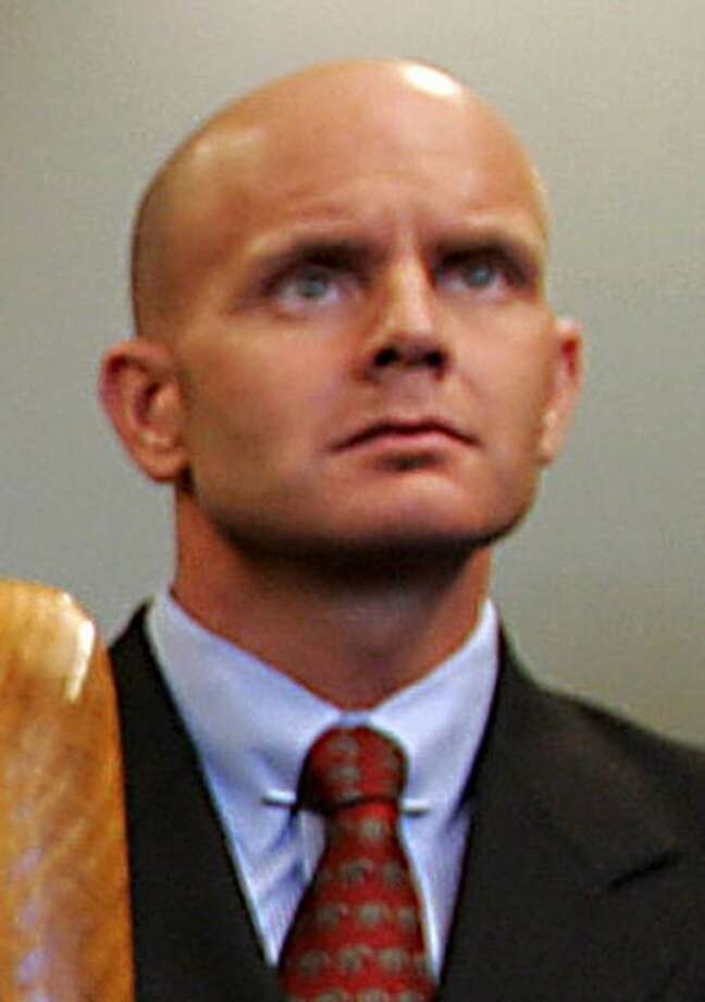 CORRECTS DATE TO JULY 27, 2005 - In this July 27, 2005 photo, FBI Agent Frederick Humphries listens during a news conference after the sentencing of Ahmed Ressam at the Federal Courthouse in Seattle. Humphries has been identified as the agent socialite Jill Kelley contacted to complain about harassing emails sent by Gen. David Petraeus' paramour, Paula Broadwell. (AP Photo/Kevin P. Casey)