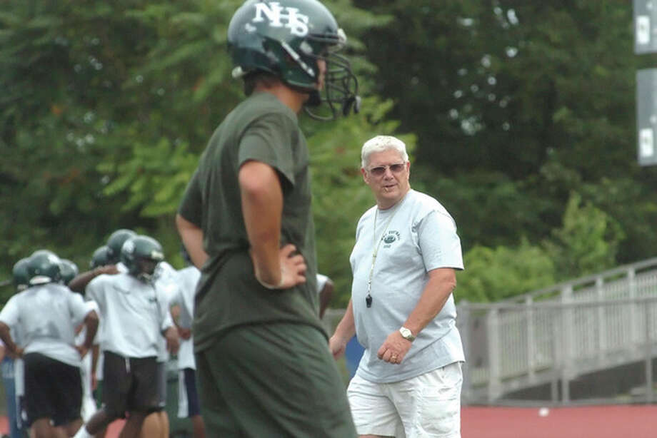 Norwalk High School football coach Pete Tucci directs practice on Wednesday at Brien McMahon High School. The turf at Norwalk High is being resurfaced. hour photo/matthew vinci / (C)2010 The Hour