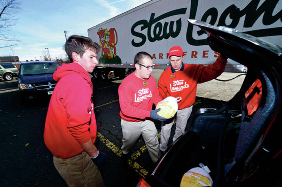 """Chris Nemer, Parry Landsman and Peter Tournas help as Stew Leonard's 33rd Annual """"Turkey Brigade"""" distributes 1,929 turkeys Thursday to more than 100 churches, civic groups, elderly housing and senior nutrition programs, and schools the Norwalk and other communities that Stew Leonard'ss serve to help provide Thanksgiving day meals for families in need.Hour photo / Erik Trautmann / (C)2012, The Hour Newspapers, all rights reserved"""